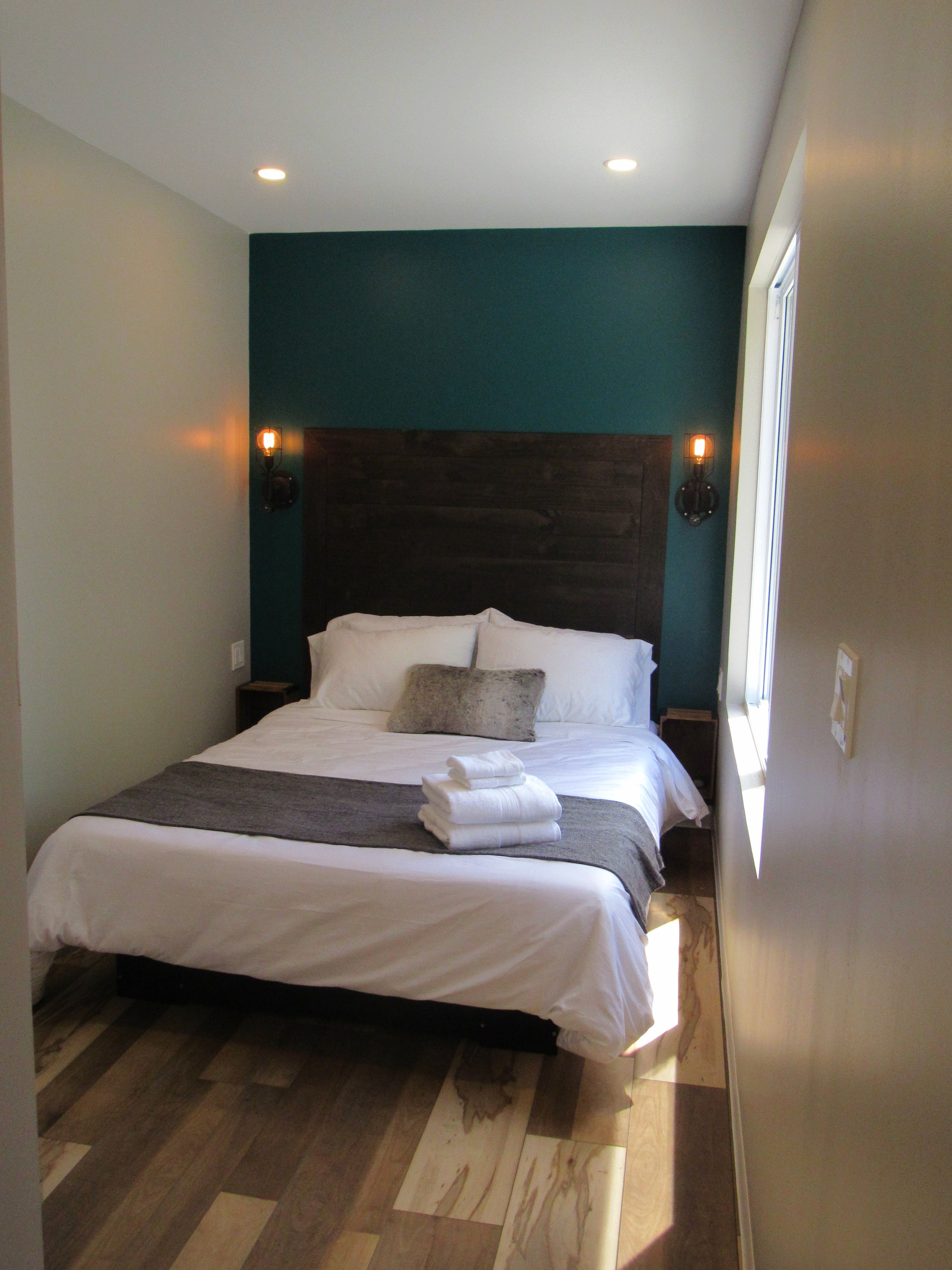 St. Jacobs Suite - has a rich wood headboard.