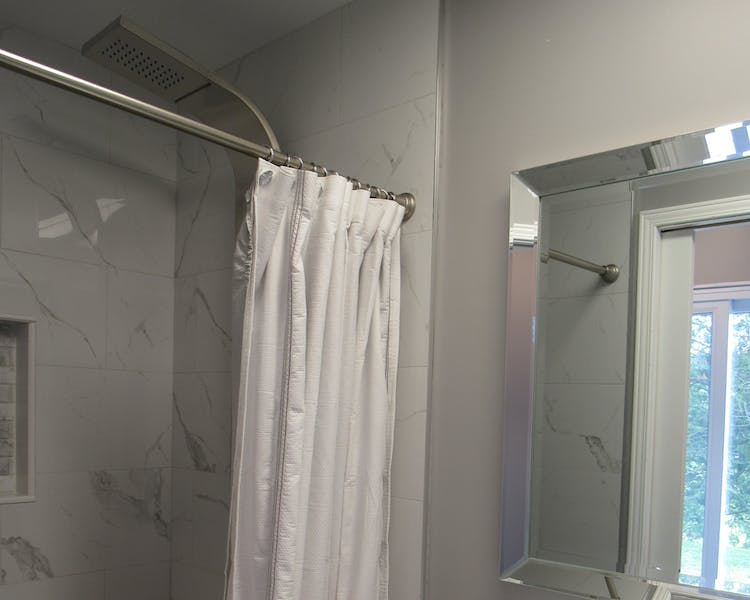 Elora Suite bathroom. Walk in shower with full body shower panel.