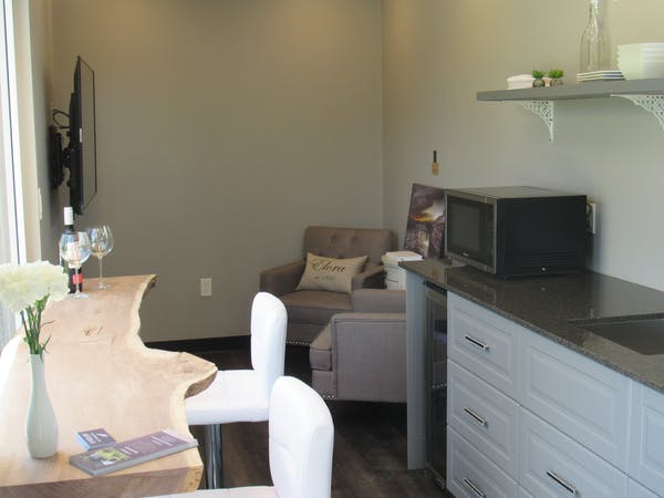 "Seating area in the Elora Suite. 55"" Flat screen TV."