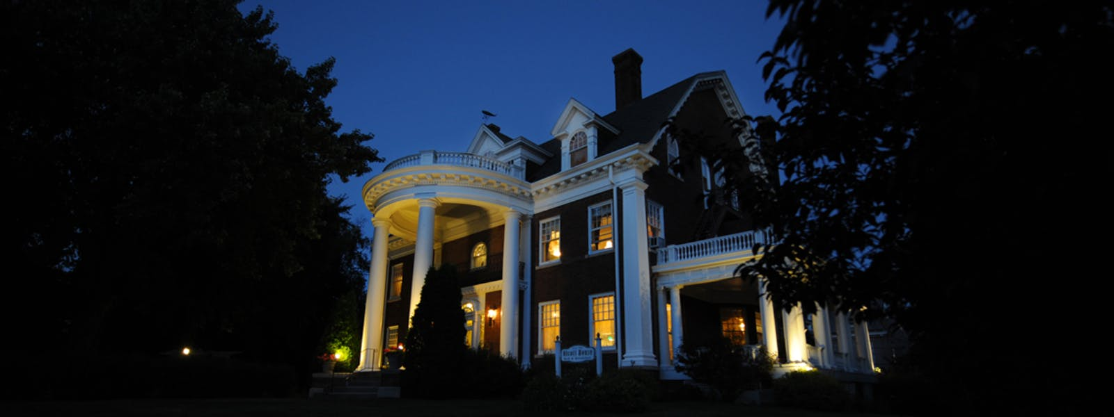 Olcott House exterior at dusk