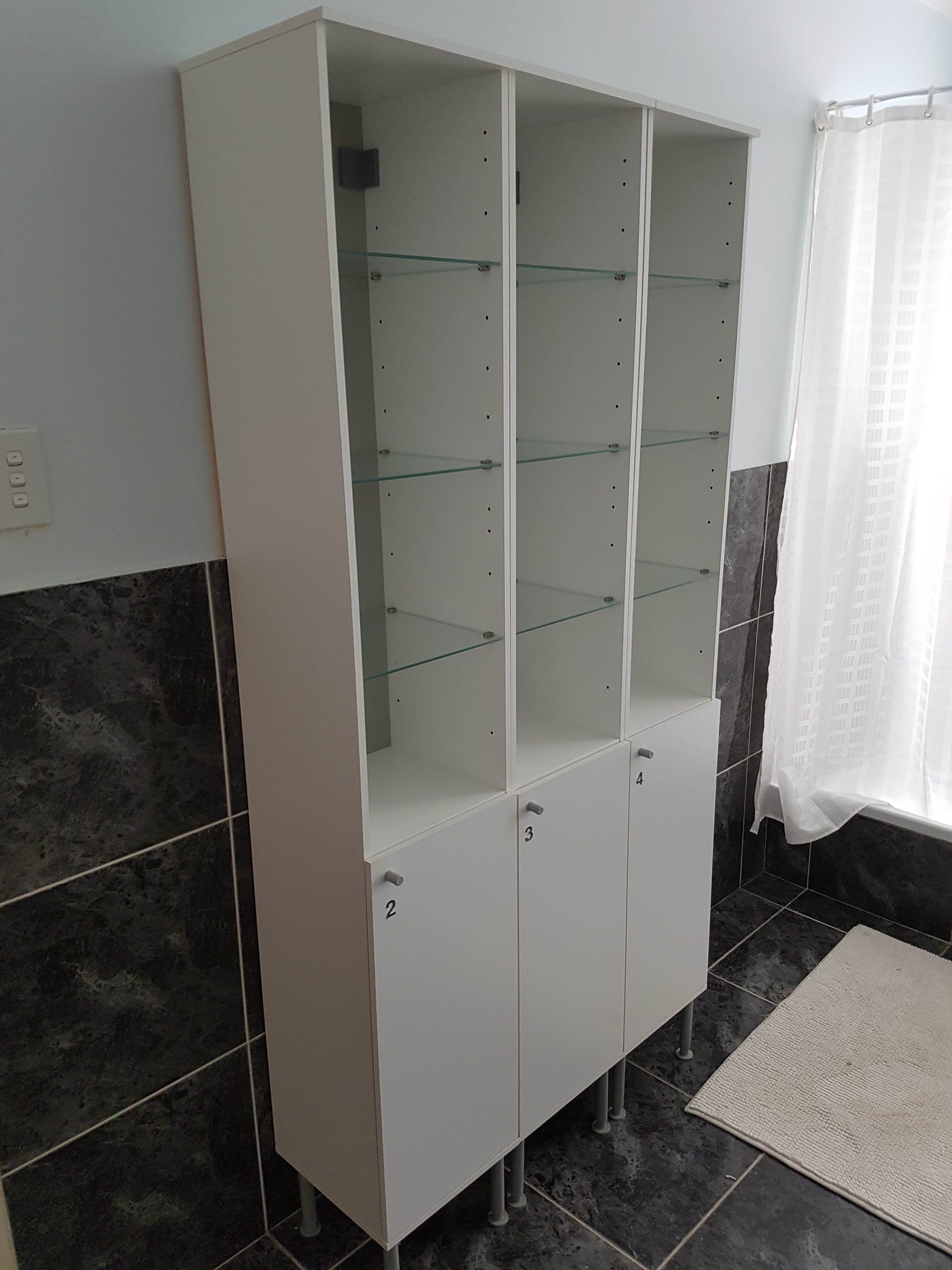 Private shelving and cabinets in shared bathroom