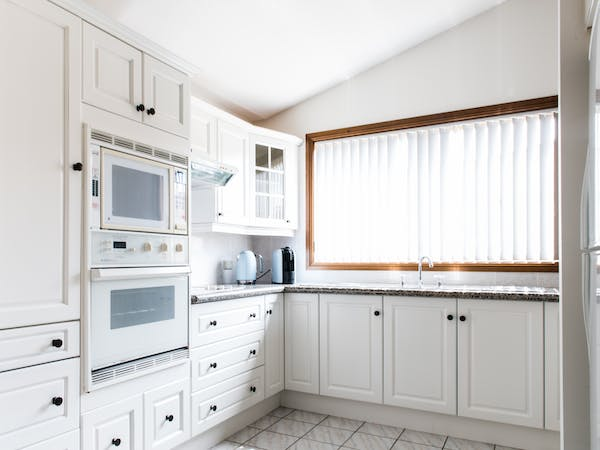 Kitchen with all equipment, oven, microwave and dish washer