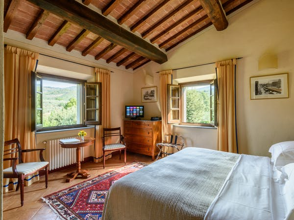 Casa Portagioia Tuscany bed and breakfast , Veterini double bedroom with views of gardens and surrounding Tuscan landscapes