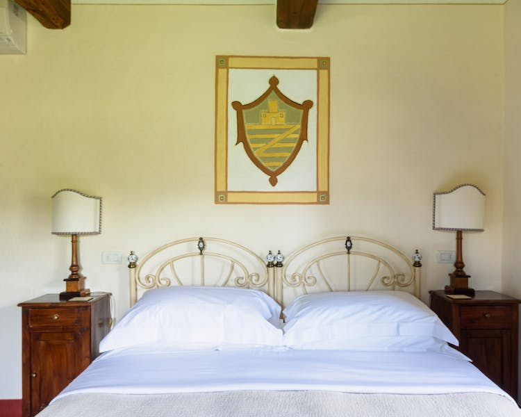 Casa Portagioia Tuscany bed and breakfast , Castelli garden room, a double bedroom with views of courtyard and olive groves.