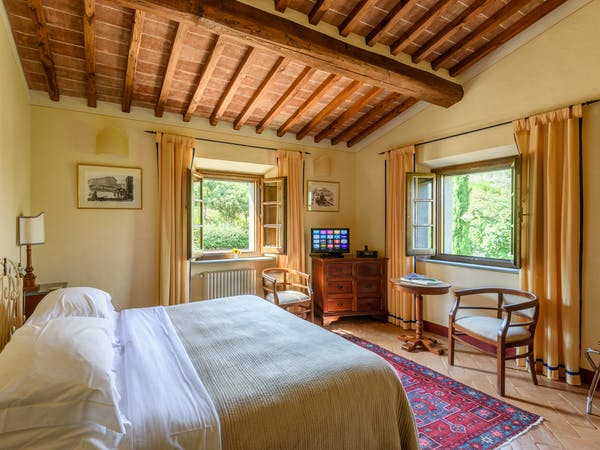 Casa Portagioia Tuscany bed and breakfast , Grilandi room, a double bedroom with views of courtyard and olive groves.