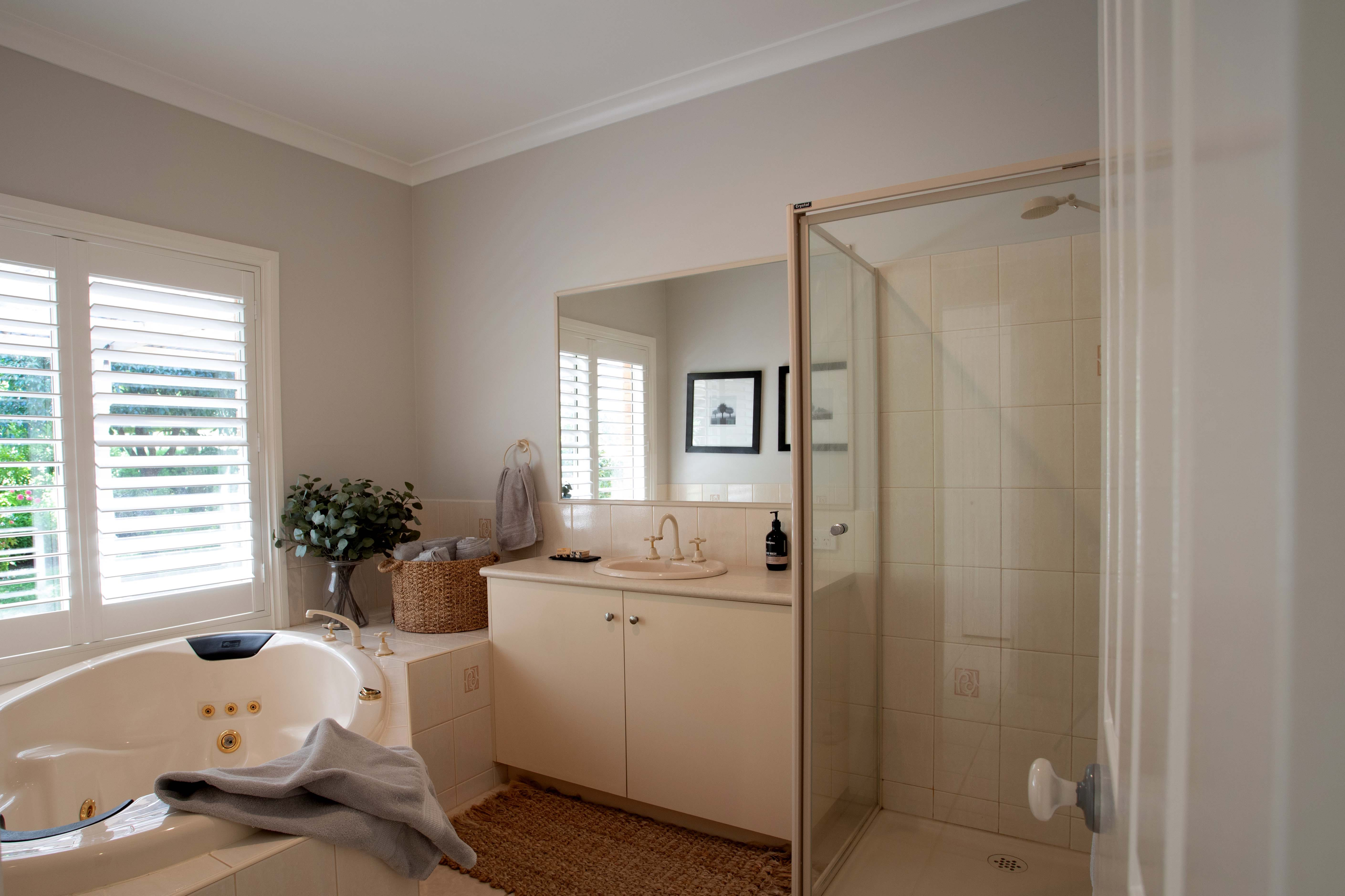Gracefield House central bathroom includes spa bath, shower and all amenities. The master suite also has its own ensuite.
