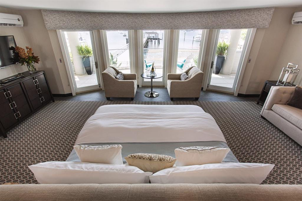 The Helm, our most spacious room with expansive views of Manhasset bay, French doors open to terrace for outside access