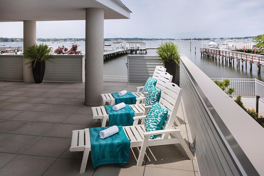 relaxing on the outdoor porch with fabulous views of Manhasset bay