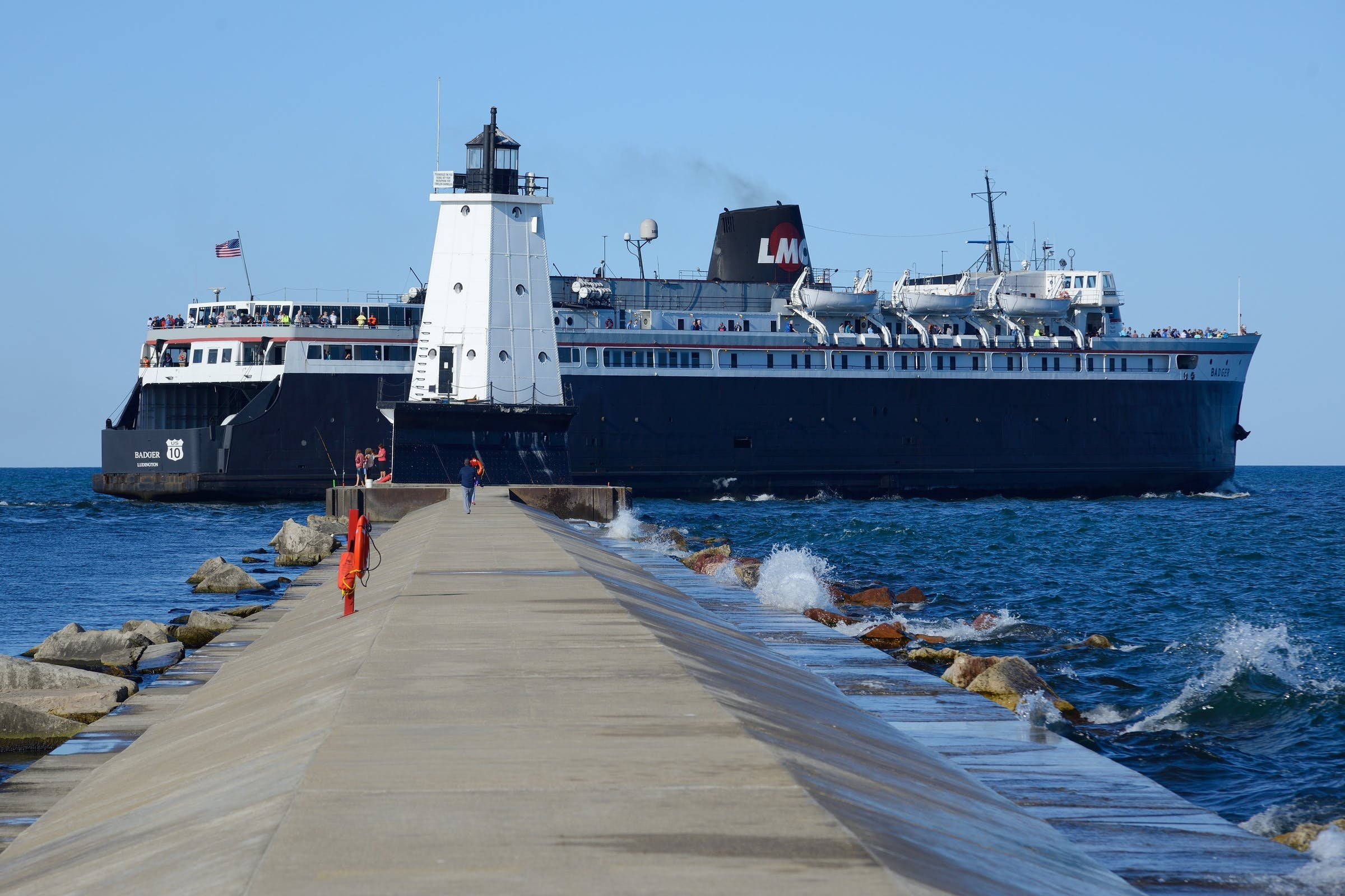 SS Badger Heading out past the Ludington North Pier Lighthouse