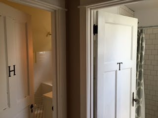 Doorways into upstairs bathrooms