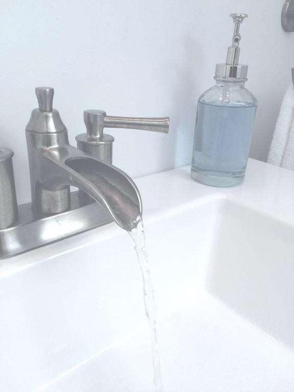 Unique faucet in private second floor guest bathroom