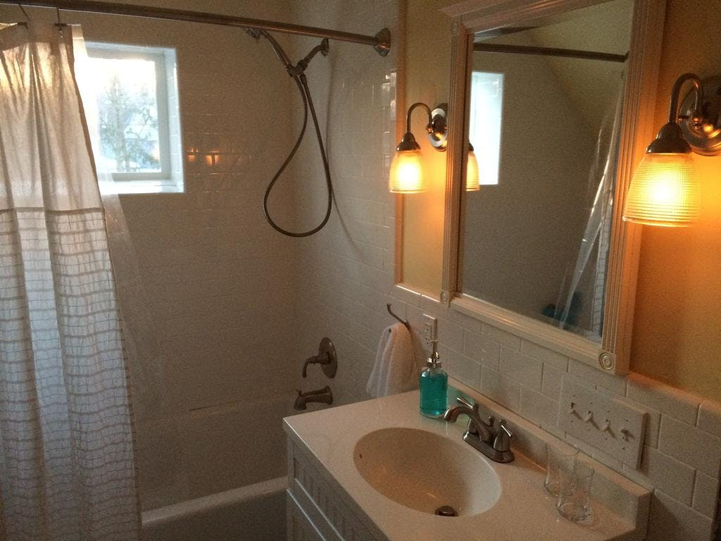 Private second floor bathroom with subway tile and soaker tub