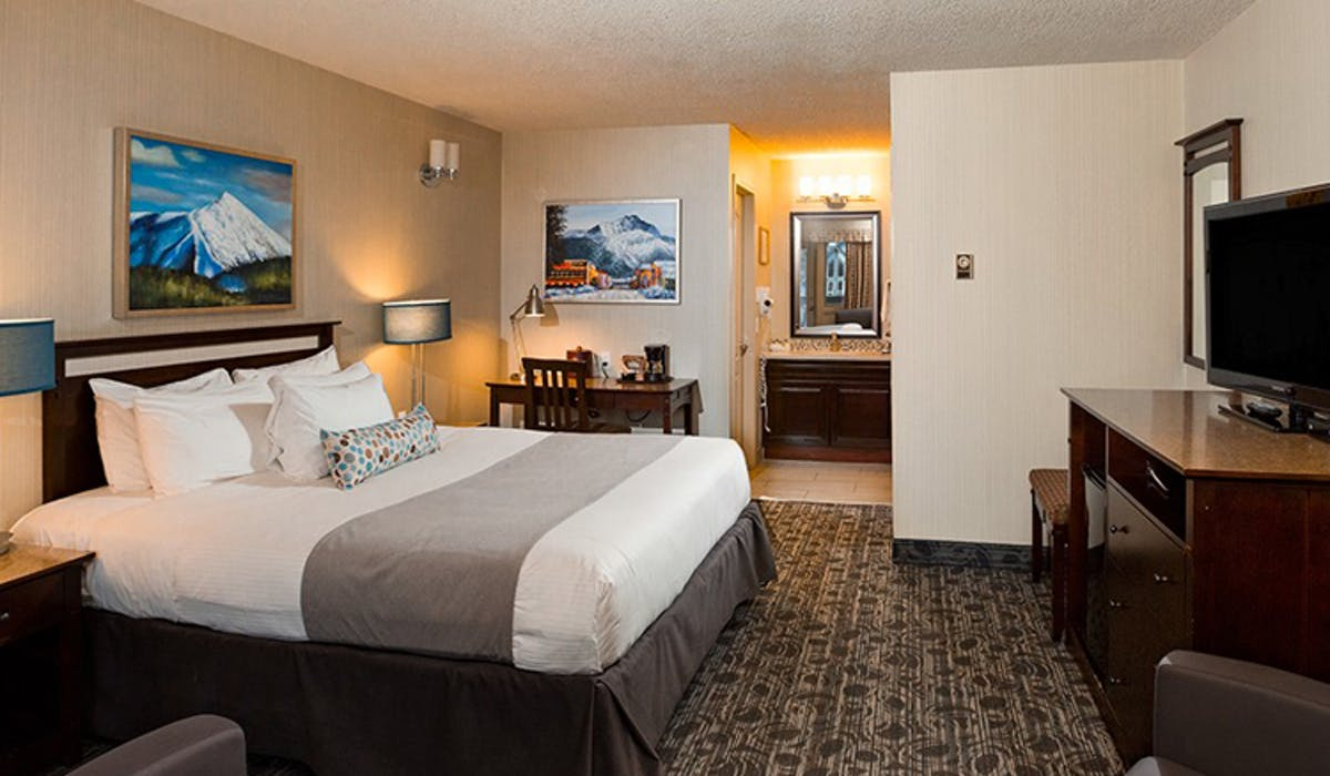 Banff High Country Inn Hotel luxury rooms Suite King Queen Bed Pool Resort Best Stay Front Desk mountains hiking