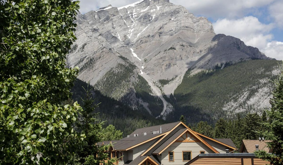 Banff High Country Inn Hotel Pool Resort Best Stay skiing Front Desk to do in Banff scenery mountains hiking flowers trails
